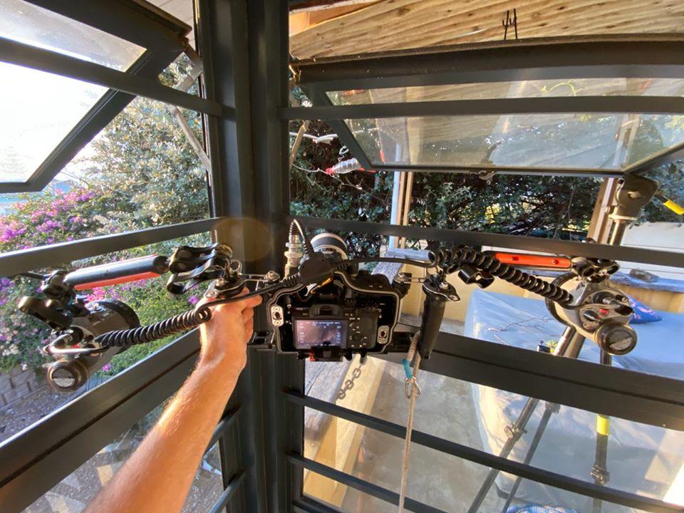 Camera rig looking through the bird hide window